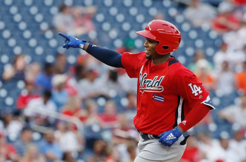WASHINGTON, DC - JULY 15: Yusniel Diaz #17 of the Los Angeles Dodgers and the World Team celebrates after hitting a solo home run in the seventh inning against the U.S. Team during the SiriusXM All-Star Futures Game at Nationals Park on July 15, 2018 in Washington, DC. (Photo by Patrick McDermott/Getty Images)