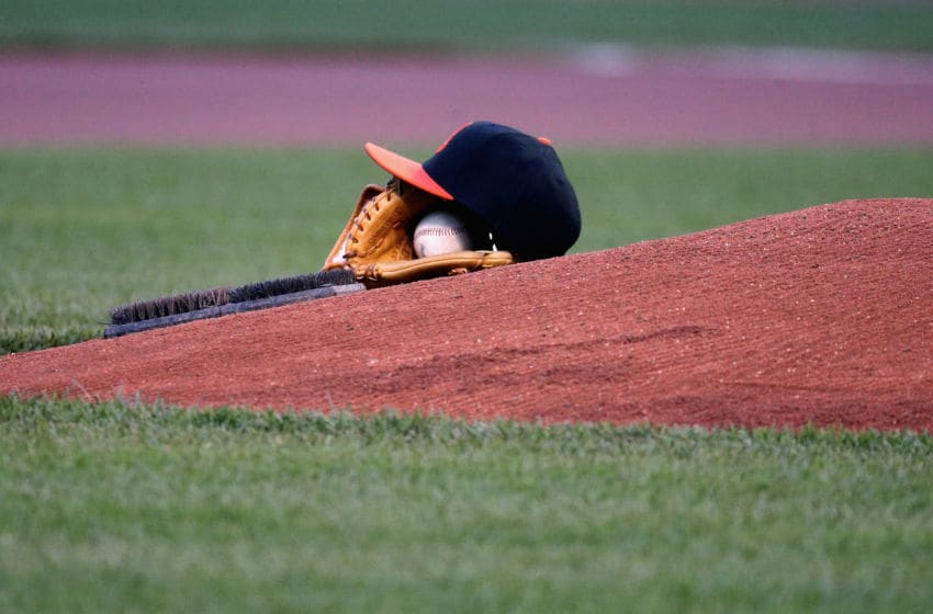 BALTIMORE, MARYLAND - APRIL 08: The cap and glove of starting pitcher Chris Tillman