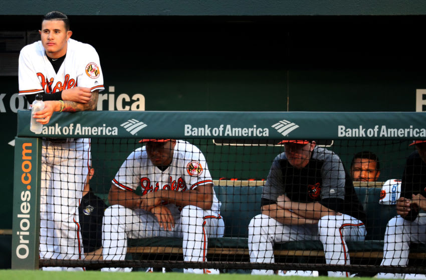 BALTIMORE, MD - MAY 9: Manny Machado #13 of the Baltimore Orioles looks on from the dugout in the first inning against the Kansas City Royals at Oriole Park at Camden Yards on May 9, 2018 in Baltimore, Maryland. (Photo by Rob Carr/Getty Images)