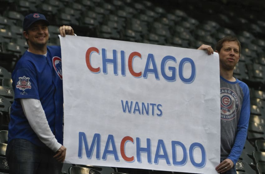 CHICAGO, IL - MAY 21: Cubs fans hold a sign saying they want Manny Machado #13 of the Baltimore Orioles traded to the Chicago Cubs before a game between the Chicago White Sox and the Baltimore Orioles on May 21, 2018 at Guaranteed Rate Field in Chicago, Illinois. (Photo by David Banks/Getty Images)
