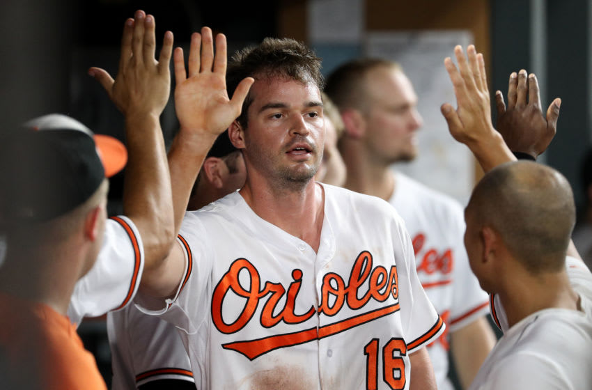 BALTIMORE, MD - AUGUST 28: Trey Mancini #16 of the Baltimore Orioles celebrates after scoring a run against the Toronto Blue Jays during the third inning at Oriole Park at Camden Yards on August 28, 2018 in Baltimore, Maryland. (Photo by Patrick Smith/Getty Images)
