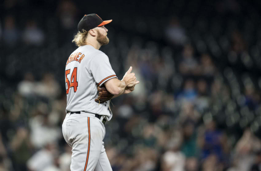 SEATTLE, WA - SEPTEMBER 5: Starting pitcher Andrew Cashner #54 of the Baltimore Orioles reacts after giving up a solo home run to Nelson Cruz #23 of the Seattle Mariners during the fifth inning of a game at Safeco Field on September 5, 2018 in Seattle, Washington. (Photo by Stephen Brashear/Getty Images)