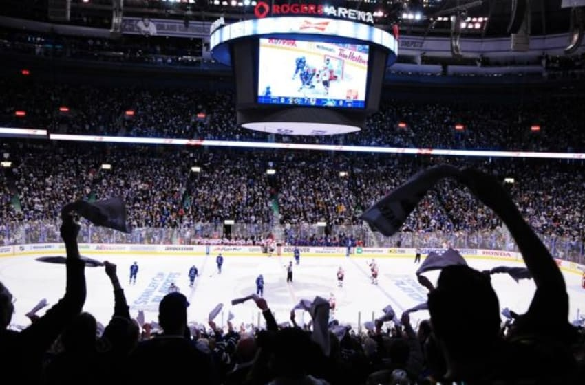 Apr 15, 2015; Vancouver, British Columbia, CAN; Vancouver Canucks fans celebrate forward Bo Horvat (53) goal against Calgary Flames goaltender Jonas Hiller (1) (not pictured) during the second period in game one of the first round of the the 2015 Stanley Cup Playoffs at Rogers Arena. Mandatory Credit: Anne-Marie Sorvin-USA TODAY Sports