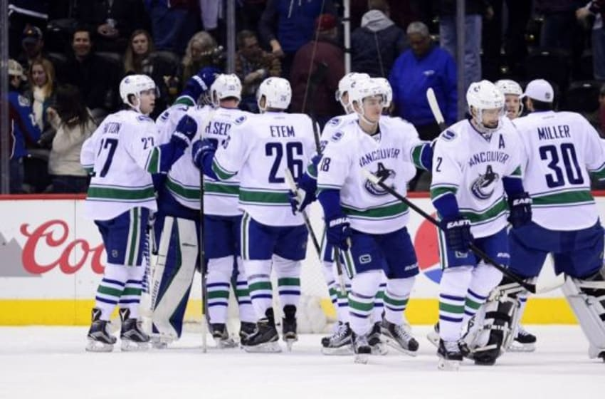 Feb 9, 2016; Denver, CO, USA; Vancouver Canucks celebrate the win over the against the Colorado Avalanche at the Pepsi Center. The Canucks defeated the Avalanche 3-1. Mandatory Credit: Ron Chenoy-USA TODAY Sports