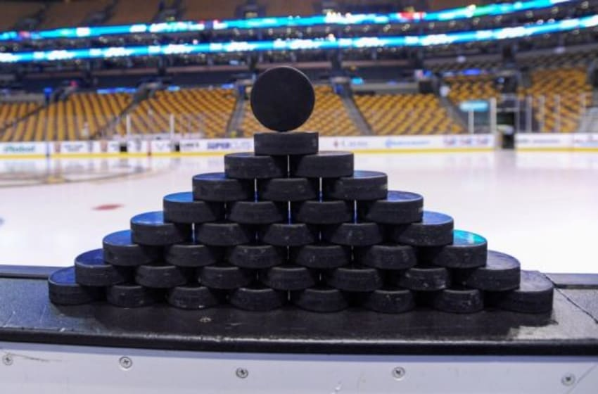 Jan 3, 2015; Boston, MA, USA; A detail view of practice pucks on the boards prior to a game between the Boston Bruins and the Ottawa Senators at TD Banknorth Garden. Mandatory Credit: Bob DeChiara-USA TODAY Sports