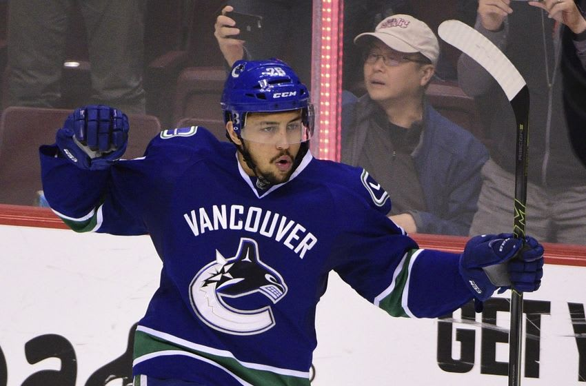 Apr 9, 2016; Vancouver, British Columbia, CAN; Vancouver Canucks forward Emerson Etem (26) celebrates after scoring a goal against Edmonton Oilers goaltender Cam Talbot (not pictured) during the shootout at Rogers Arena. The Vancouver Canucks won 4-3. Mandatory Credit: Anne-Marie Sorvin-USA TODAY Sports