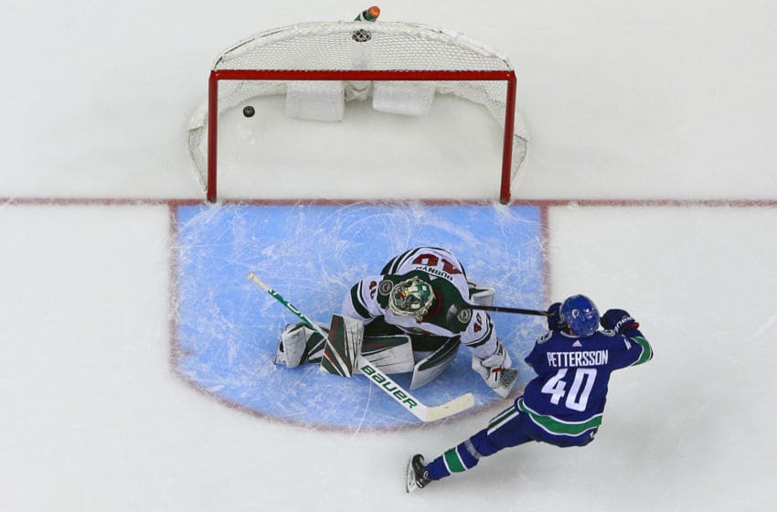 VANCOUVER, BC - OCTOBER 29: Elias Pettersson #40 of the Vancouver Canucks scores on Devan Dubnyk #40 of the Minnesota Wild during their NHL game at Rogers Arena October 29, 2018 in Vancouver, British Columbia, Canada. Vancouver won 5-2. (Photo by Jeff Vinnick/NHLI via Getty Images)