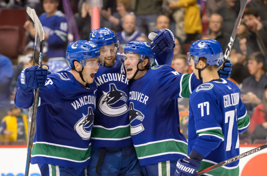 VANCOUVER, BC - DECEMBER 16: Vancouver Canucks Defenseman Alexander Edler (23) is congratulated by Right wing Brock Boeser (6) Right wing Nikolay Goldobin (77) and Center Bo Horvat (53) after scoring a goal against the Edmonton Oilers during their NHL game at Rogers Arena on December 16, 2018 in Vancouver, British Columbia, Canada. (Photo by Derek Cain/Icon Sportswire via Getty Images)