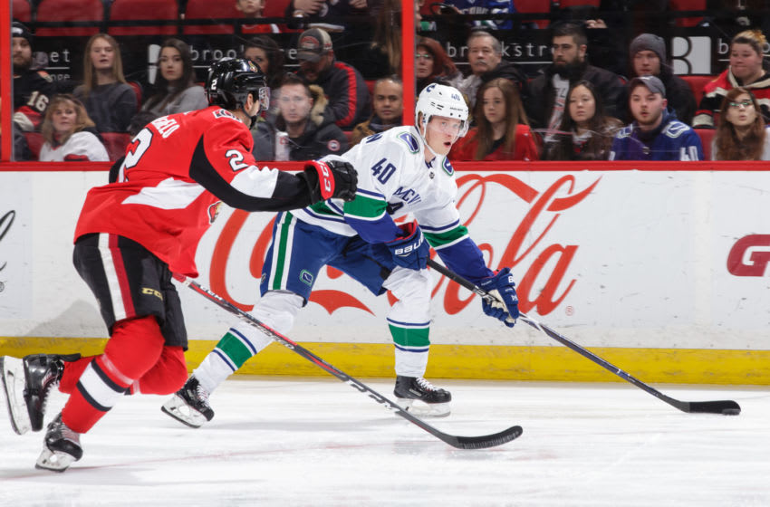 OTTAWA, ON - JANUARY 2: Dylan DeMelo #2 of the Ottawa Senators defends against Elias Pettersson #40 of the Vancouver Canucks in the first period at Canadian Tire Centre on January 2, 2019 in Ottawa, Ontario, Canada. (Photo by Jana Chytilova/Freestyle Photography/Getty Images)