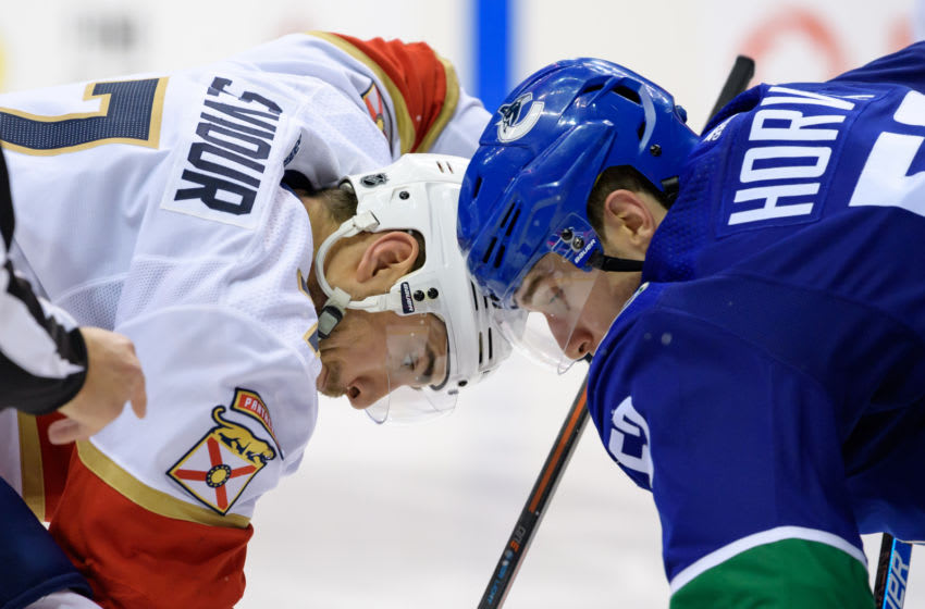 VANCOUVER, BC - JANUARY 13: Florida Panthers Center Colton Sceviour (7) faces off against Vancouver Canucks Center Bo Horvat (53) during their NHL game at Rogers Arena on January 13, 2019 in Vancouver, British Columbia, Canada. Vancouver won 5-1. (Photo by Derek Cain/Icon Sportswire via Getty Images)