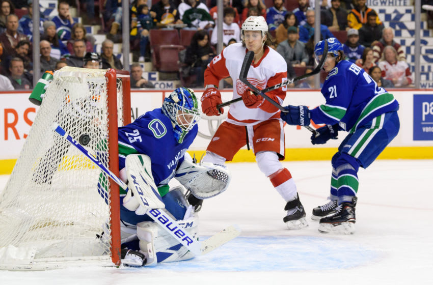 VANCOUVER, BC - JANUARY 20: Vancouver Canucks Goaltender Jacob Markstrom (25) makes a save as Left wing Loui Eriksson (21) defends against Detroit Red Wings Left Wing Tyler Bertuzzi (59) during their NHL game at Rogers Arena on January 20, 2019 in Vancouver, British Columbia, Canada. Vancouver won 3-2. (Photo by Derek Cain/Icon Sportswire via Getty Images)