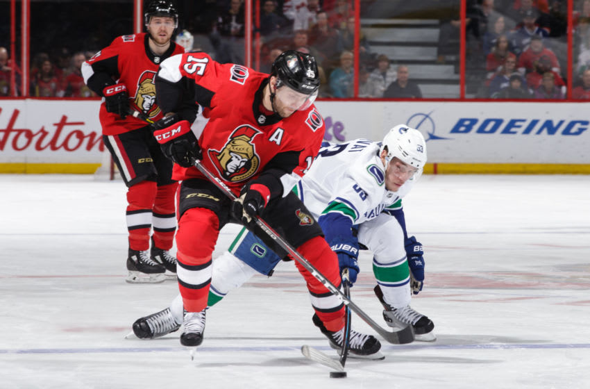 OTTAWA, ON - JANUARY 2: Zack Smith #15 of the Ottawa Senators battles for the puck possession against Bo Horvat #53 of the Vancouver Canucks at Canadian Tire Centre on January 2, 2019 in Ottawa, Ontario, Canada. (Photo by Jana Chytilova/Freestyle Photography/Getty Images)