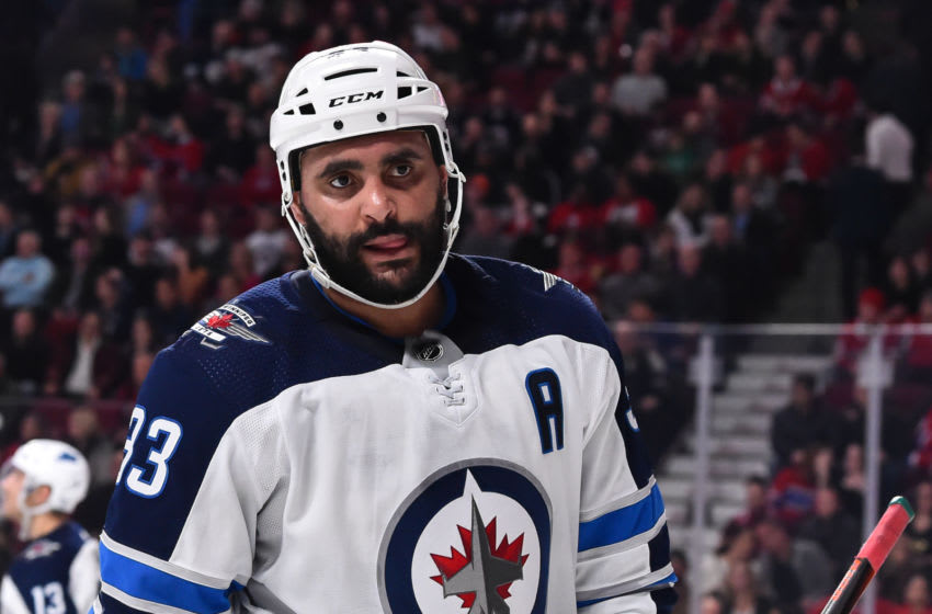 MONTREAL, QC - FEBRUARY 07: Dustin Byfuglien #33 of the Winnipeg Jets looks on against the Montreal Canadiens during the NHL game at the Bell Centre on February 7, 2019 in Montreal, Quebec, Canada. The Montreal Canadiens defeated the Winnipeg Jets 5-2. (Photo by Minas Panagiotakis/Getty Images)