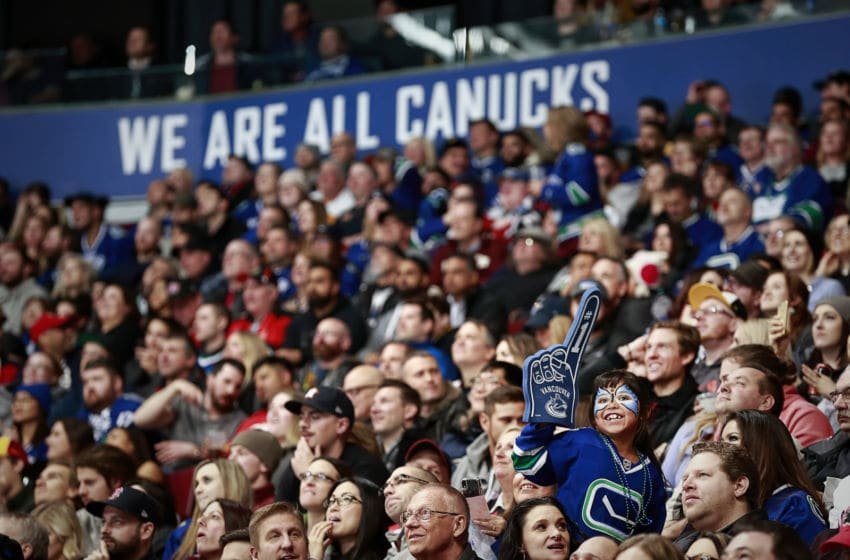 VANCOUVER, BC - FEBRUARY 9: A Vancouver Canuck fan cheers during their NHL game against the Calgary Flames at Rogers Arena February 9, 2019 in Vancouver, British Columbia, Canada. (Photo by Jeff Vinnick/NHLI via Getty Images)