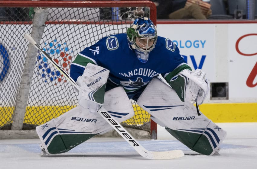 VANCOUVER, BC - FEBRUARY 9: Goalie Michael DiPietro #75 of the Vancouver Canucks readies to make a save during the team warm up prior to NHL action against the Calgary Flames on February, 9, 2019 at Rogers Arena in Vancouver, British Columbia, Canada. (Photo by Rich Lam/Getty Images)