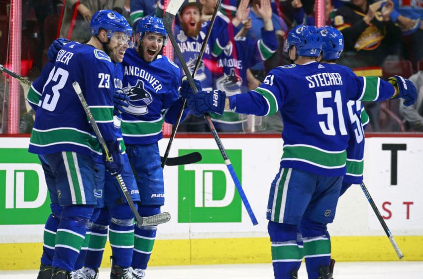 VANCOUVER, BC - MARCH 26: Josh Leivo #17 of the Vancouver Canucks is congratulated by teammates after scoring during their NHL game against the Anaheim Ducks at Rogers Arena March 26, 2019 in Vancouver, British Columbia, Canada. Anaheim won 5-4. (Photo by Jeff Vinnick/NHLI via Getty Images)