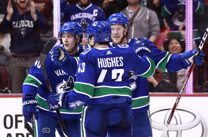 VANCOUVER, BC - MARCH 28: Brock Boeser #6 of the Vancouver Canucks is congratulated by teammates Quinn Hughes #43 an d Elias Pettersson #40 after scoring during their NHL game against the Los Angeles Kings at Rogers Arena March 28, 2019 in Vancouver, British Columbia, Canada. Vancouver won 3-2. (Photo by Jeff Vinnick/NHLI via Getty Images)