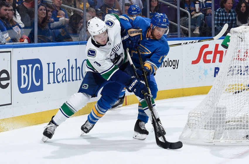 ST. LOUIS, MO - APRIL 6: Brogan Rafferty #3 of the Vancouver Canucks and Jaden Schwartz #17 of the St. Louis Blues battle for the puck at Enterprise Center on April 6, 2019 in St. Louis, Missouri. (Photo by Joe Puetz/NHLI via Getty Images)