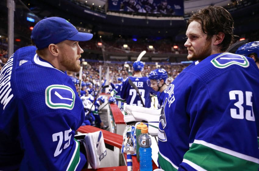 VANCOUVER, BC - MARCH 28: Jacob Markstrom #25 talks to Thatcher Demko #35 of the Vancouver Canucks during their NHL game against the Los Angeles Kings at Rogers Arena March 28, 2019 in Vancouver, British Columbia, Canada. (Photo by Jeff Vinnick/NHLI via Getty Images)