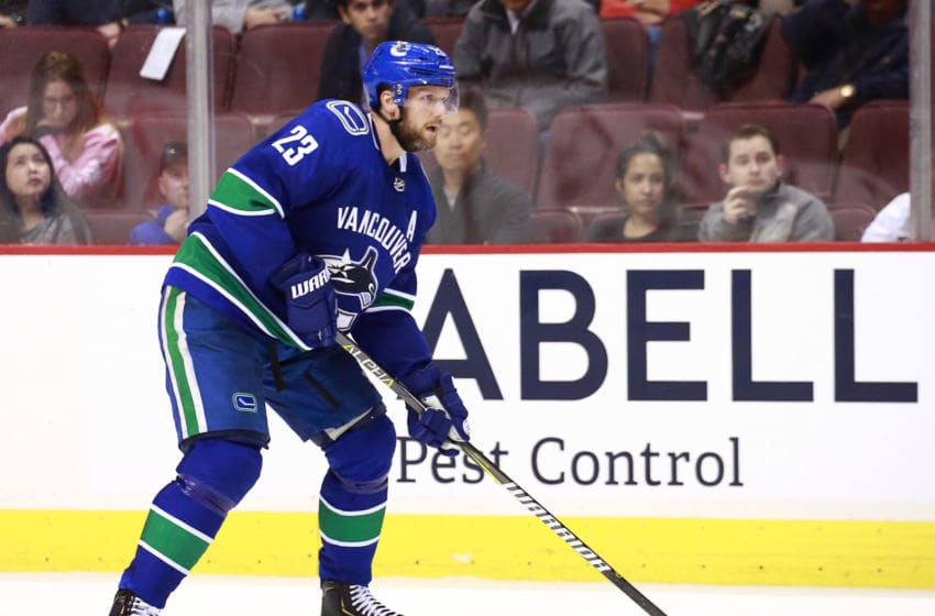 VANCOUVER, BC - MARCH 20: Alexander Edler #23 of the Vancouver Canucks skates up ice during their NHL game against the Ottawa Senators at Rogers Arena March 20, 2019 in Vancouver, British Columbia, Canada. (Photo by Jeff Vinnick/NHLI via Getty Images)