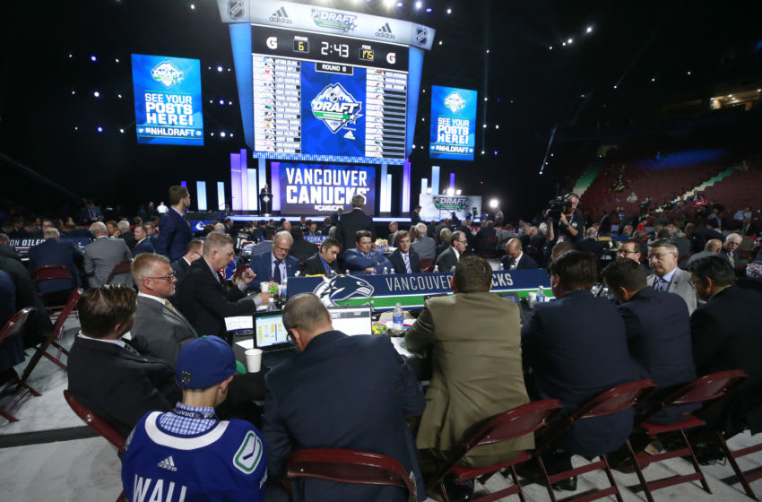 VANCOUVER, BRITISH COLUMBIA - JUNE 22: A general view of the Vancouver Canucks draft table is seen during Rounds 2-7 of the 2019 NHL Draft at Rogers Arena on June 22, 2019 in Vancouver, Canada. (Photo by Jeff Vinnick/NHLI via Getty Images)