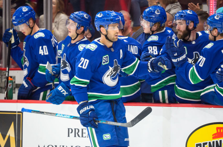 VANCOUVER, BC - SEPTEMBER 17: Vancouver Canucks Center Brandon Sutter (20) is congratulated at the players bench after scoring a goal against the Edmonton Oilers during their NHL game at Rogers Arena on September 17, 2019 in Vancouver, British Columbia, Canada. (Photo by Derek Cain/Icon Sportswire via Getty Images)