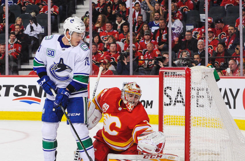 CALGARY, AB - OCTOBER 05: Michael Ferland #79 of the Vancouver Canucks takes a shot on the net of David Rittich #33 of the Calgary Flames during an NHL game at Scotiabank Saddledome on October 5, 2019 in Calgary, Alberta, Canada. (Photo by Derek Leung/Getty Images)
