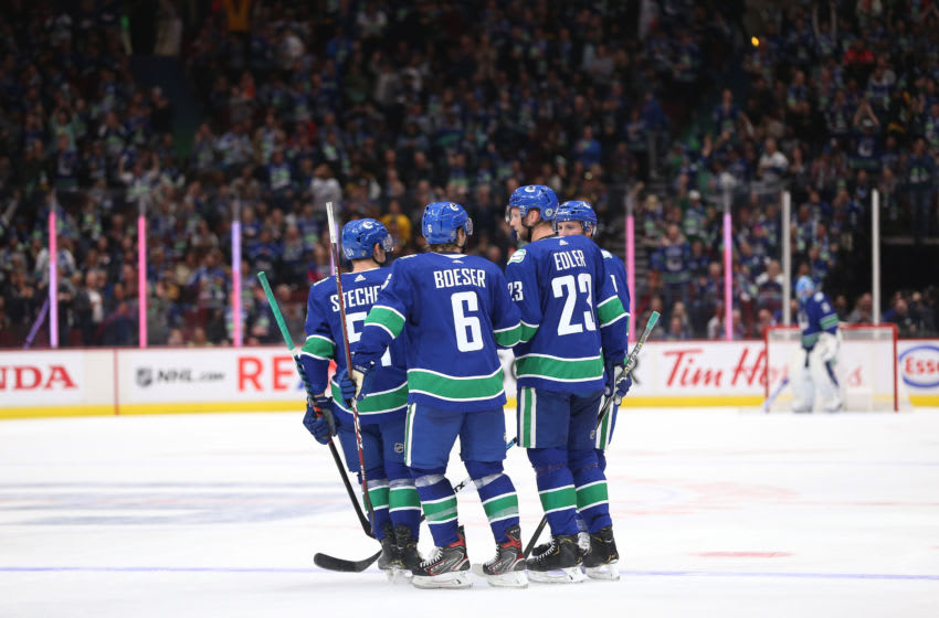 VANCOUVER, BC - OCTOBER 09: Alexander Edler #23 of the Vancouver Canucks celebrates his goal against the Los Angeles Kings with teammates Troy Stetcher #51, Brock Boeser #6 and J.T Miller #9 during the third period at Rogers Arena on October 9, 2019 in Vancouver, Canada. (Photo by Ben Nelms/Getty Images)
