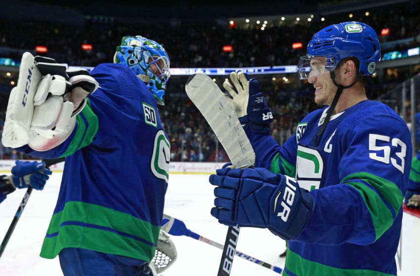 VANCOUVER, BC - OCTOBER 12: Bo Horvat #53 of the Vancouver Canucks congratulates teammate Jacob Markstrom #25 after winning their NHL game against the Philadelphia Flyers at Rogers Arena October 12, 2019 in Vancouver, British Columbia, Canada. Vancouver won 3-2 in a shootout. (Photo by Jeff Vinnick/NHLI via Getty Images)