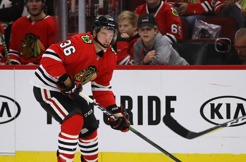 CHICAGO, ILLINOIS - SEPTEMBER 18: Matthew Highmore #36 of the Chicago Blackhawks advances the puck against the Detroit Red Wings during a preseason game at the United Center on September 18, 2019 in Chicago, Illinois. (Photo by Jonathan Daniel/Getty Images)