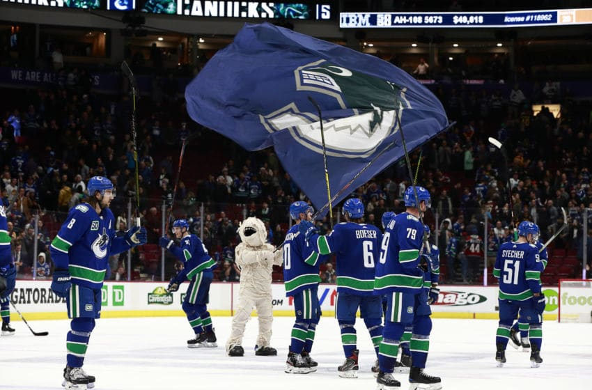 VANCOUVER, BC - OCTOBER 28: Vancouver Canucks players and Canucks mascot Fin wave to fans after the Canucks win against the Florida Panthers at Rogers Arena October 28, 2019 in Vancouver, British Columbia, Canada. Vancouver won 7-2. (Photo by Jeff Vinnick/NHLI via Getty Images)