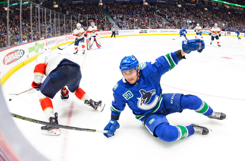 VANCOUVER, BC - OCTOBER 28: Vancouver Canucks Left Wing Micheal Ferland (79) is tripped up by Florida Panthers Defenceman Aaron Ekblad (5) during their NHL game at Rogers Arena on October 28, 2019 in Vancouver, British Columbia, Canada. (Photo by Derek Cain/Icon Sportswire via Getty Images)