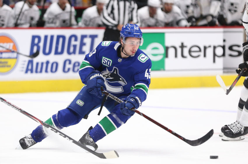 VANCOUVER, BC - OCTOBER 09: Quinn Hughes #43 of the Vancouver Canucks skates against the Los Angeles Kings at Rogers Arena on October 9, 2019 in Vancouver, Canada. (Photo by Ben Nelms/Getty Images)