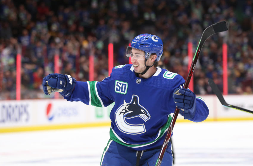 VANCOUVER, BC - OCTOBER 09: Quinn Hughes #4 of the Vancouver Canucks celebrates his first NHL goal against the Los Angeles Kings at Rogers Arena on October 9, 2019 in Vancouver, Canada. (Photo by Ben Nelms/Getty Images)