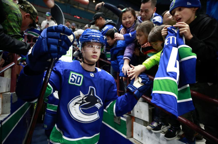 VANCOUVER, BC - NOVEMBER 12: Elias Pettersson #40 of the Vancouver Canucks walks out to the ice past fans during their NHL game against the Nashville Predators at Rogers Arena November 12, 2019 in Vancouver, British Columbia, Canada. Vancouver won 5-3. (Photo by Jeff Vinnick/NHLI via Getty Images)