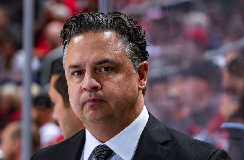 DETROIT, MI - OCTOBER 22: Head coach Travis Green of the Vancouver Canucks watches the action from the bench against the Detroit Red Wings during an NHL game at Little Caesars Arena on October 22, 2019 in Detroit, Michigan. Vancouver defeated Detroit 5-2. (Photo by Dave Reginek/NHLI via Getty Images)