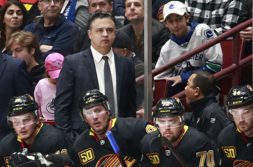 VANCOUVER, BC - NOVEMBER 16: Head coach Travis Green of the Vancouver Canucks looks on from the bench during their NHL game against the Colorado Avalanche at Rogers Arena November 16, 2019 in Vancouver, British Columbia, Canada. Colorado won 5-4. (Photo by Jeff Vinnick/NHLI via Getty Images)
