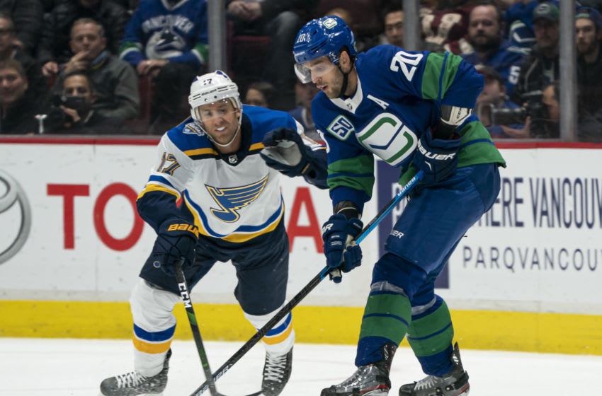 VANCOUVER, BC - NOVEMBER 05: Jaden Schwartz #17 of the St. Louis Blues tries to check Brandon Sutter #20 of the Vancouver Canucks off the puck during NHL action at Rogers Arena on November 5, 2019 in Vancouver, Canada. (Photo by Rich Lam/Getty Images)