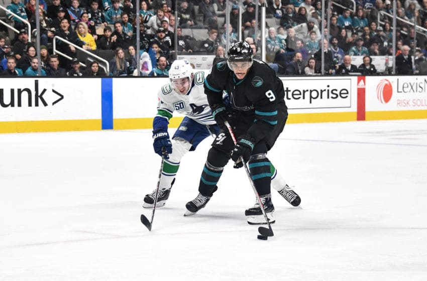 SAN JOSE, CA - DECEMBER 14: Evander Kane #9 of the San Jose Sharks skates ahead with the puck against Quinn Hughes #43 of the Vancouver Canucks at SAP Center on December 14, 2019 in San Jose, California. (Photo by Brandon Magnus/NHLI via Getty Images)