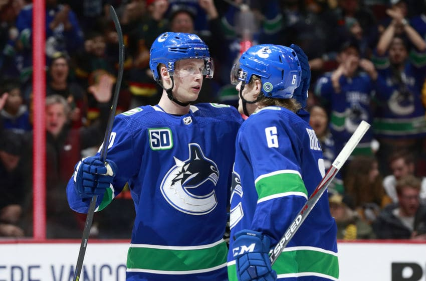 VANCOUVER, BC - DECEMBER 21: Brock Boeser #6 of the Vancouver Canucks is congratulated by teammate Elias Pettersson #40 after scoring during their NHL game against the Pittsburgh Penguins at Rogers Arena December 21, 2019 in Vancouver, British Columbia, Canada. (Photo by Jeff Vinnick/NHLI via Getty Images)