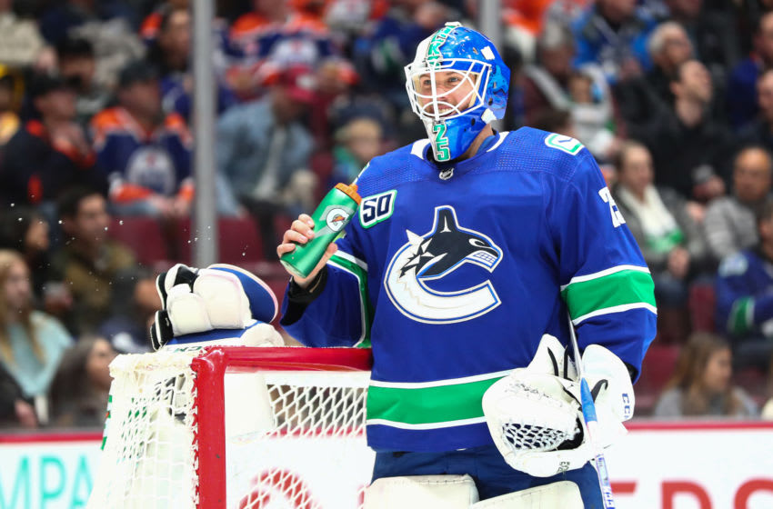 VANCOUVER, BC - DECEMBER 23: Vancouver Canucks Goalie Jacob Markstrom (25) takes a water break while playing the Edmonton Oilers during their NHL game at Rogers Arena on December 23, 2019 in Vancouver, British Columbia, Canada. (Photo by Devin Manky/Icon Sportswire via Getty Images)