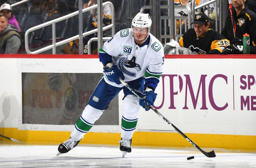 PITTSBURGH, PA - NOVEMBER 27: J.T. Miller #9 of the Vancouver Canucks skates against the Pittsburgh Penguins at PPG PAINTS Arena on November 27, 2019 in Pittsburgh, Pennsylvania. (Photo by Joe Sargent/NHLI via Getty Images)