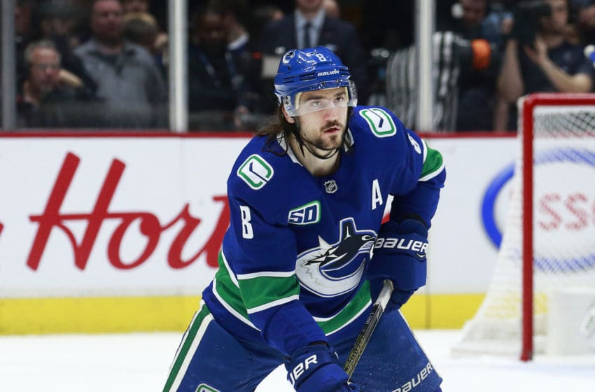 VANCOUVER, BC - DECEMBER 1: Christopher Tanev #8 of the Vancouver Canucks skates up ice during their NHL game against the Edmonton Oilers at Rogers Arena December 1, 2019 in Vancouver, British Columbia, Canada. (Photo by Jeff Vinnick/NHLI via Getty Images)