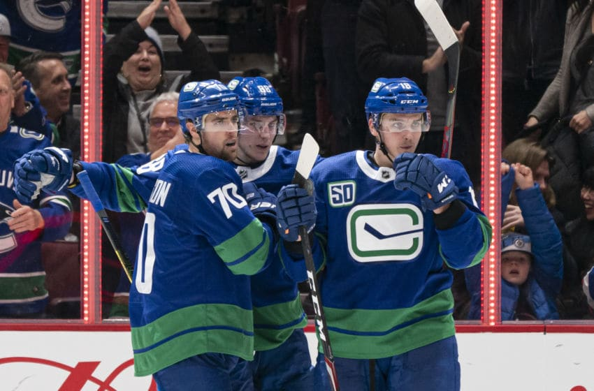 VANCOUVER, BC - JANUARY 18: Tanner Pearson #70 of the Vancouver Canucks celebrates with teammates Adam Gaudette #88 and Jake Virtanen#18 after scoring a goal against the San Jose Sharks in NHL action on January, 18, 2020 at Rogers Arena in Vancouver, British Columbia, Canada. (Photo by Rich Lam/Getty Images)
