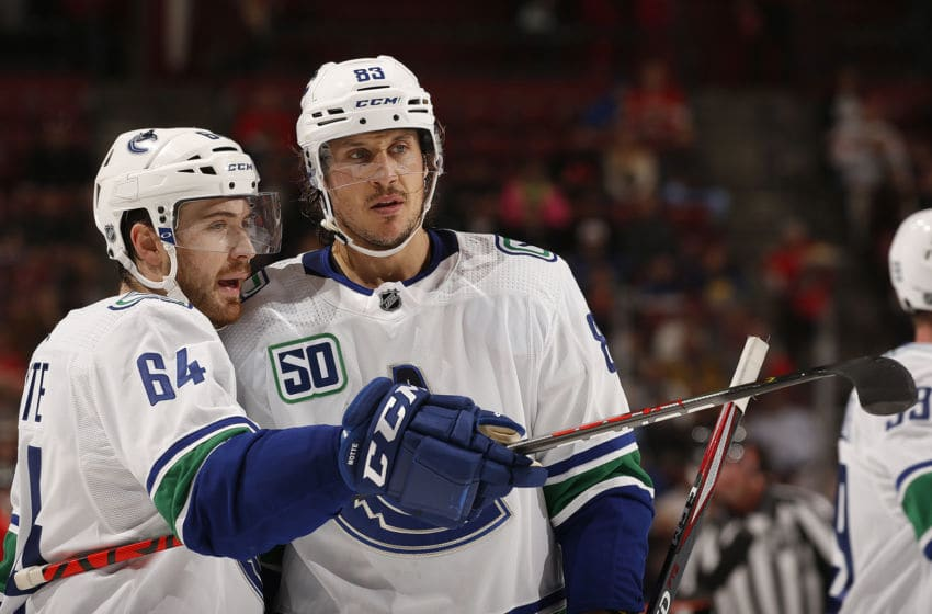 SUNRISE, FL - JANUARY 09: Tyler Motte #64 of the Vancouver Canucks chats with teammate Jay Beagle #83 during a break in the acton against the Florida Panthers at the BB&T Center on January 9, 2020 in Sunrise, Florida. (Photo by Eliot J. Schechter/NHLI via Getty Images)