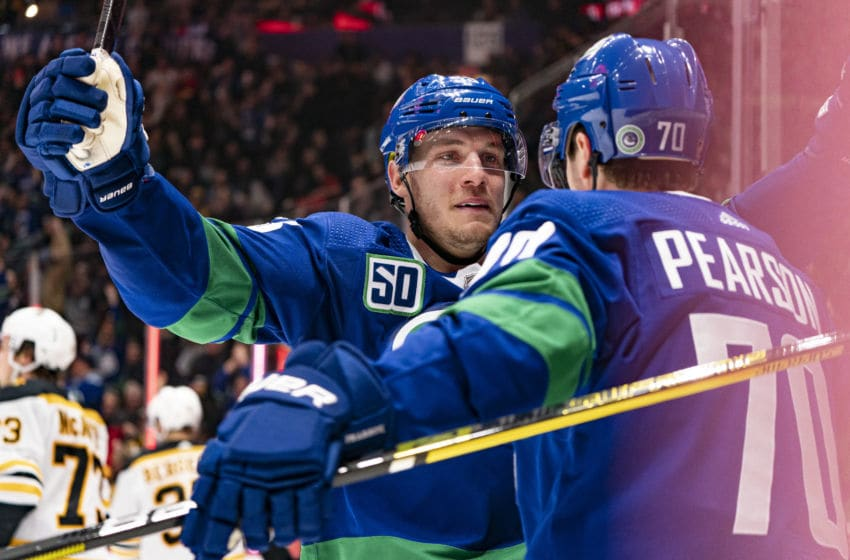 VANCOUVER, BC - FEBRUARY 22: Bo Horvat #53 of the Vancouver Canucks congratulates teammate Tanner Pearson #70 after scoring a goal against the Boston Bruins during NHL action at Rogers Arena on February 22, 2020 in Vancouver, Canada. (Photo by Rich Lam/Getty Images)
