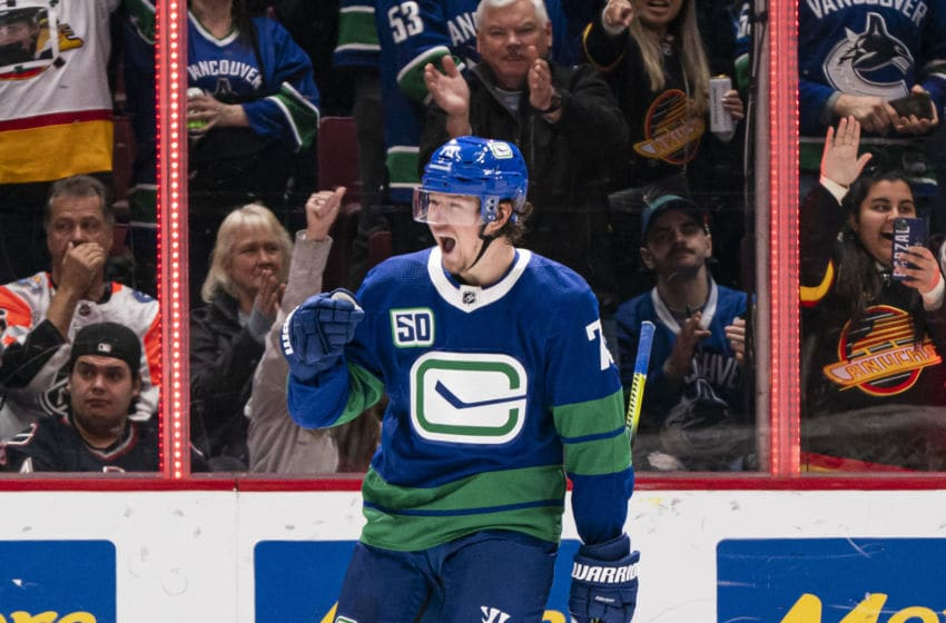 VANCOUVER, BC - FEBRUARY 22: Tyler Toffoli #73 of the Vancouver Canucks celebrates after scoring a goal against the Boston Bruins during NHL action at Rogers Arena on February 22, 2020 in Vancouver, Canada. (Photo by Rich Lam/Getty Images)