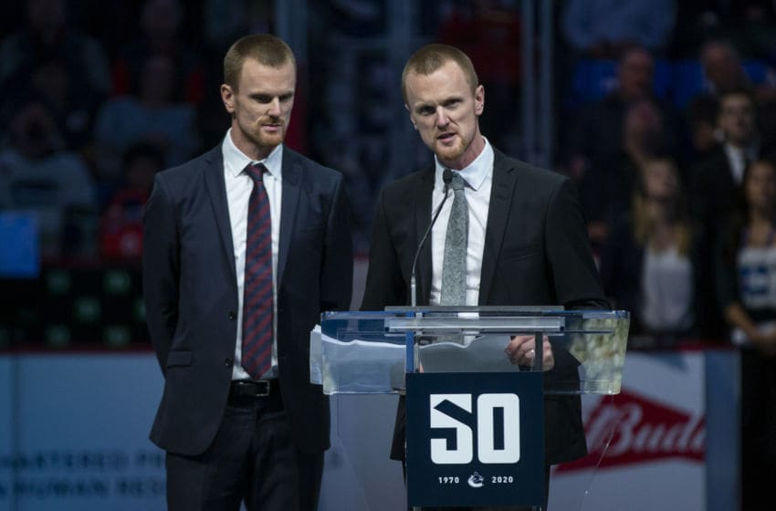 VANCOUVER, BC - FEBRUARY 20: Henrik Sedin speaks to the crowd near Daniel Sedin during a ceremony celebrating their careers as Vancouver Canucks on February 12, 2020 in Vancouver, Canada. (Photo by Ben Nelms/Getty Images)