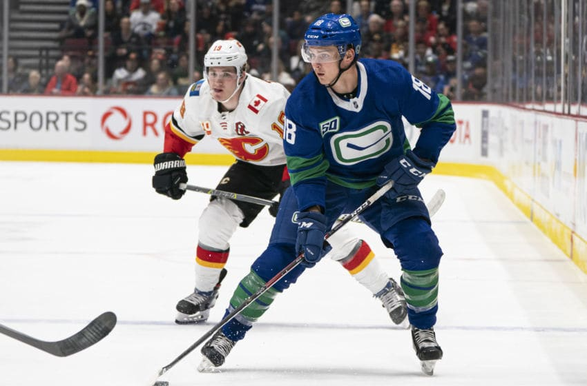 VANCOUVER, BC - FEBRUARY 08: Jake Virtanen #18 of the Vancouver Canucks skates with the puck in NHL action against the Calgary Flames at Rogers Arena on February 8, 2020 in Vancouver, Canada. (Photo by Rich Lam/Getty Images)