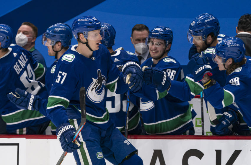VANCOUVER, BC - FEBRUARY 13: Tyler Myers #57 of the Vancouver Canucks celebrates after scoring what proves to be be the game winning goal against the Calgary Flames during NHL hockey action at Rogers Arena on February 13, 2021 in Vancouver, Canada. (Photo by Rich Lam/Getty Images)